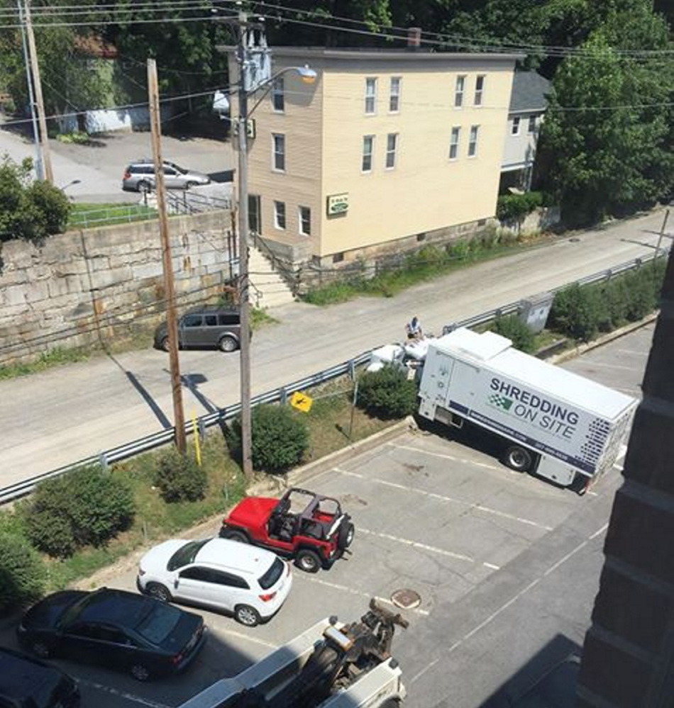 A Shredding On Site truck rolled across the street and into a cement wall Monday morning in Augusta.
