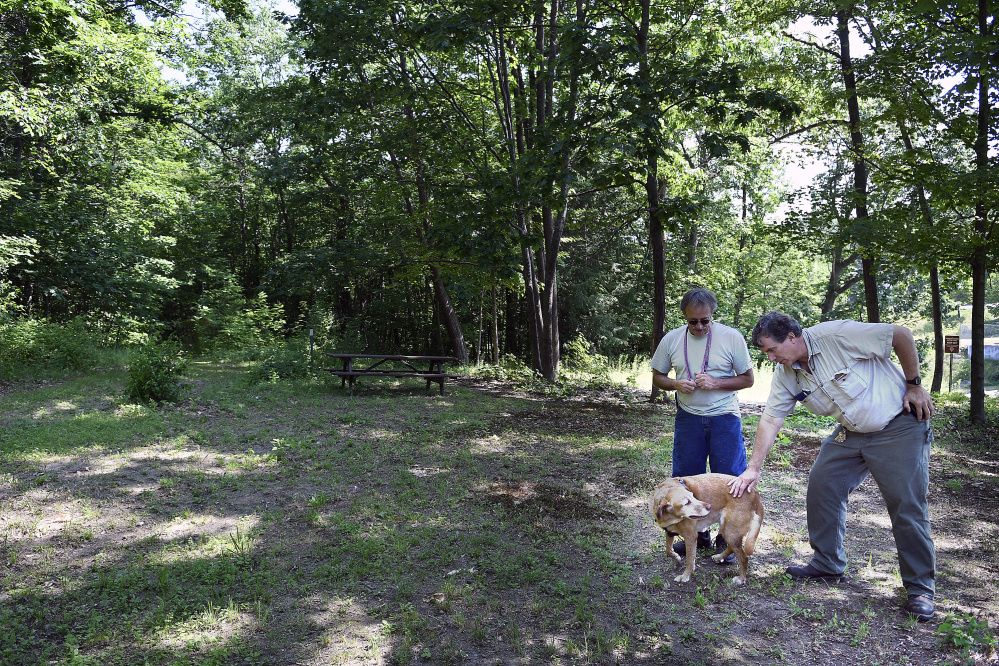 Mike Firlotte and Doug Clark confer Monday on the Harrison Avenue Nature Trail near Firlotte's home in Gardiner.