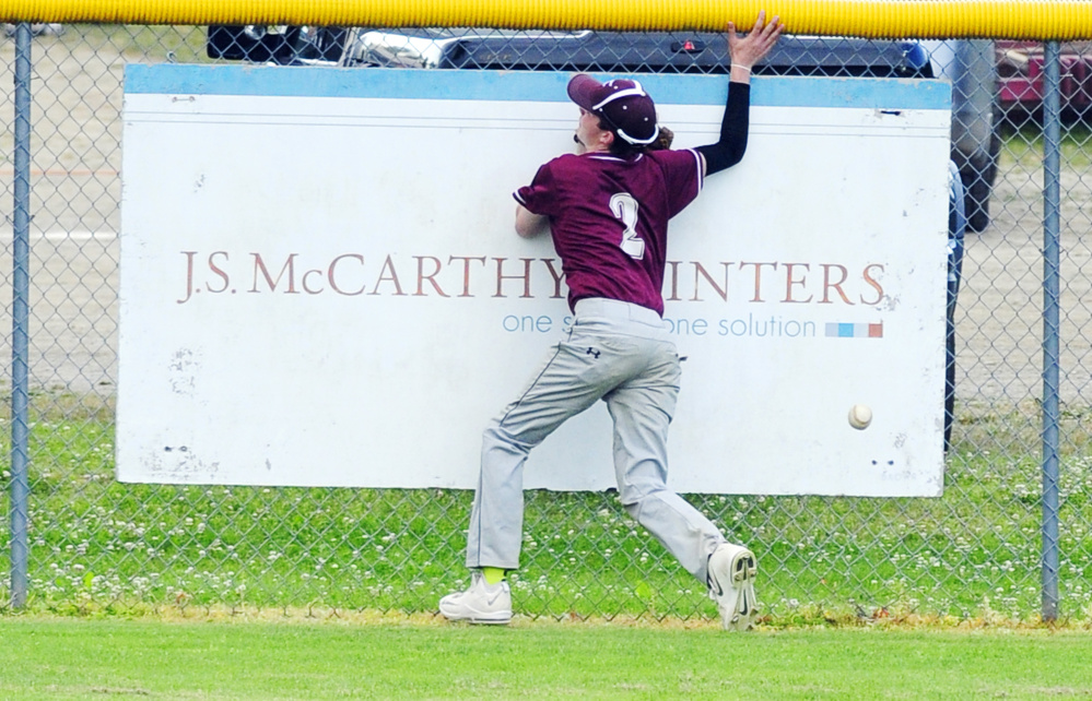 Franklin center fielder David McDonald hits the Morton Field fance chasing a long fly ball during a Zone 2 playoff game Tuesday in Augusta.