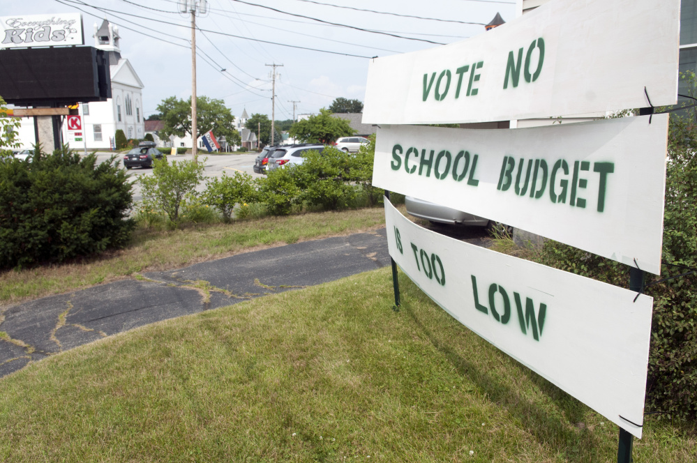 """David Hughes recently put out a sign saying, """"Vote No: School Budget Is Too Low"""" at his home, on corner of Main and Royal streets in Winthrop."""