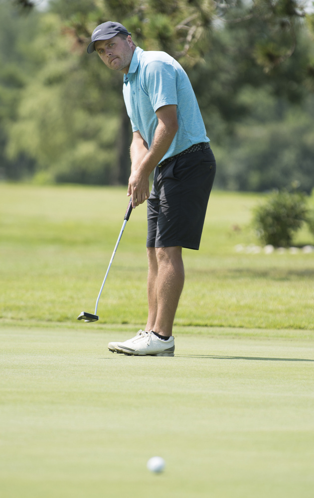 Tyler Vrolyk of Glen Allen, Virginia watches his putt on the 7th green of Bangor Municipal Golf Course on Friday.  Vrolyk is one of several golfers who are putting in long miles in order to compete in golf tournaments.