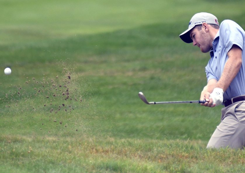 Sam Grindle, of Deer Isle, works his way out of a bunker during the first round of the Maine Open in Manchester on Monday.