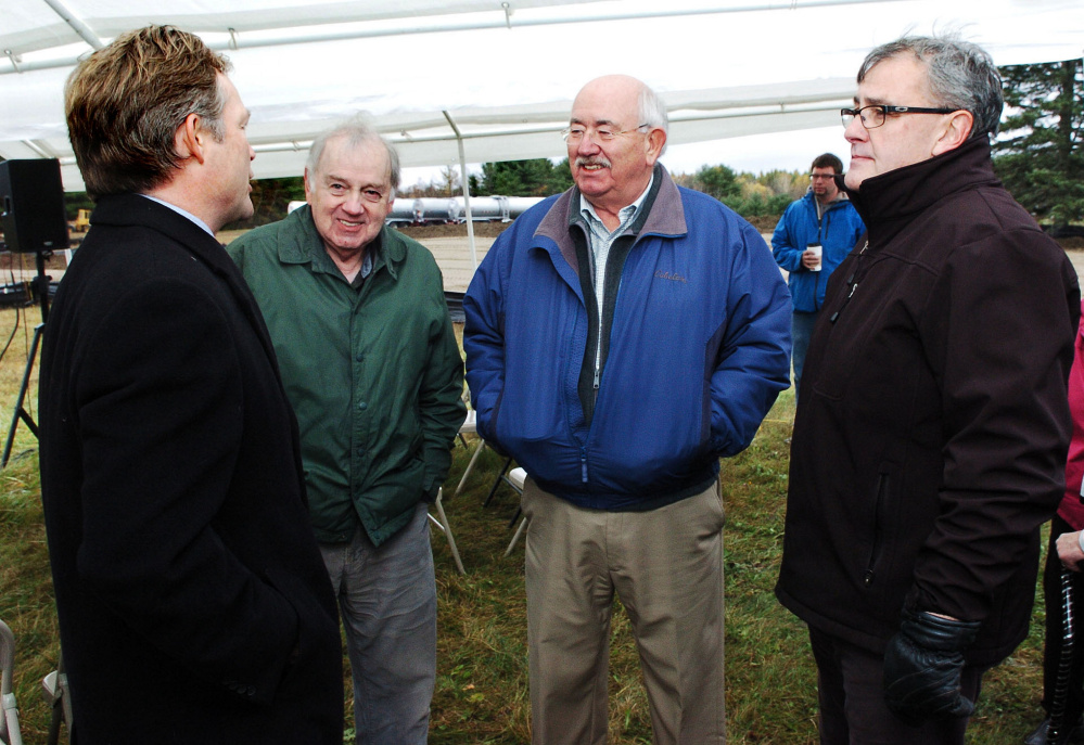 Attorney Dan Walker of Preti Flaherty, left, speaks with, from left, Elery Keene and Ken Fletcher, both of Winslow, and Gary Bowman of Oakland prior to a groundbreaking ceremony for the Fiberight solid waste facility on the Coldbrook Road in Hampden on Oct. 26, 2016. The latest edition of the Municipal Review Committee's newsletter affirms that the plant will be ready April 1, 2018, to accept waste from these two communities and 113 others that have agreed to send their waste to Hampden.