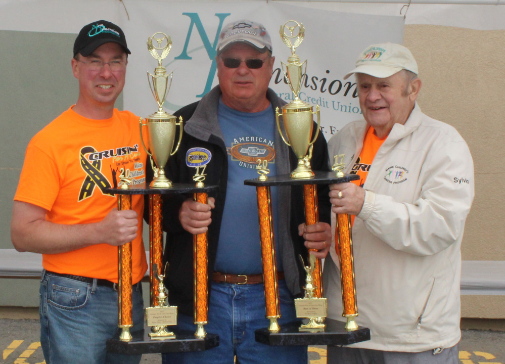 Ryan Poulin, left, president/CEO of New Dimensions Federal Credit Union, with Lincoln Nye, winner of People's Choice and Best of Show trophies, and Sylvio Normandeau, right.
