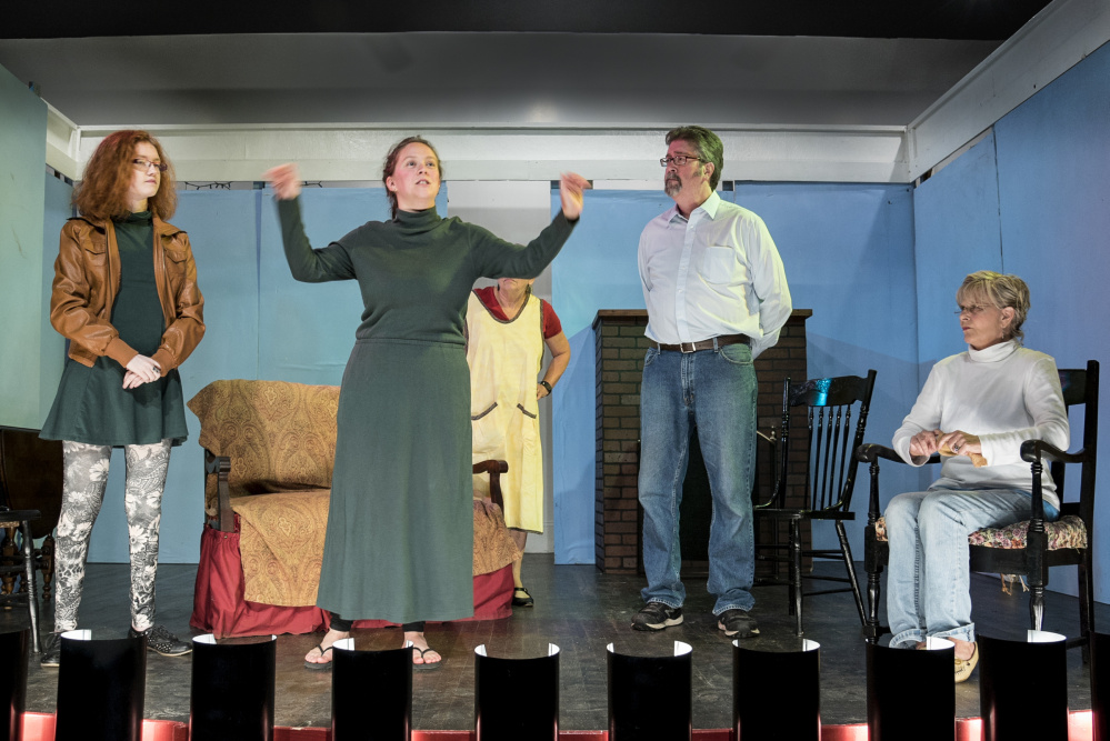 """Allison Kuhns, center, waves her arms Monday while rehearsing her role as Miss Lettie Madden in the Vienna Historical Society annual play production of """"Doctor's Orders.""""  She is joined on stage by Delaney Crocker, left, Chris Crocker, second from right and Karla Arceneaux, right."""