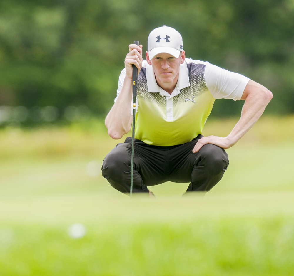 Staff photo by Joe Phelan   Jason Thresher squats down to line up a shot during the final round of the Charlie's Maine Open on Tuesday at the Augusta Country Club in Manchester.