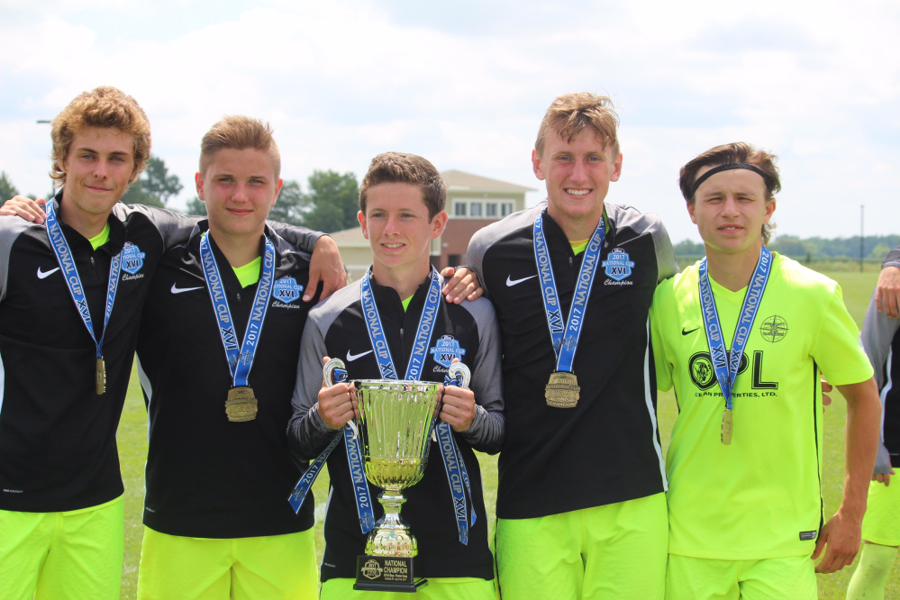 From left to right, Hayden Elwell, Mike Wildes, Jack Moore, Cole Smith and Jake Warn stand with the National Cup they won with the Seacoast United U-19 team Monday in Westfield, Indiana.