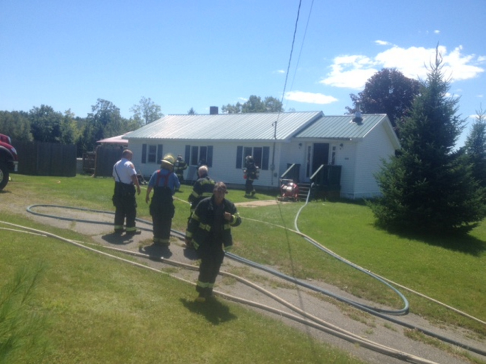 Firefighters from Skowhegan and Norridgewock converged upon this Mercer home to put out a smoky fire Wednesday.