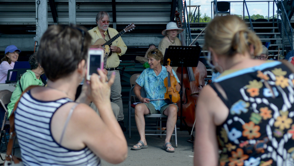 The Reel People Band takes a breather during their performance at the Maine Artisan Bread Fair at the Skowhegan Fair Grounds on Saturday, July 30, 2016.