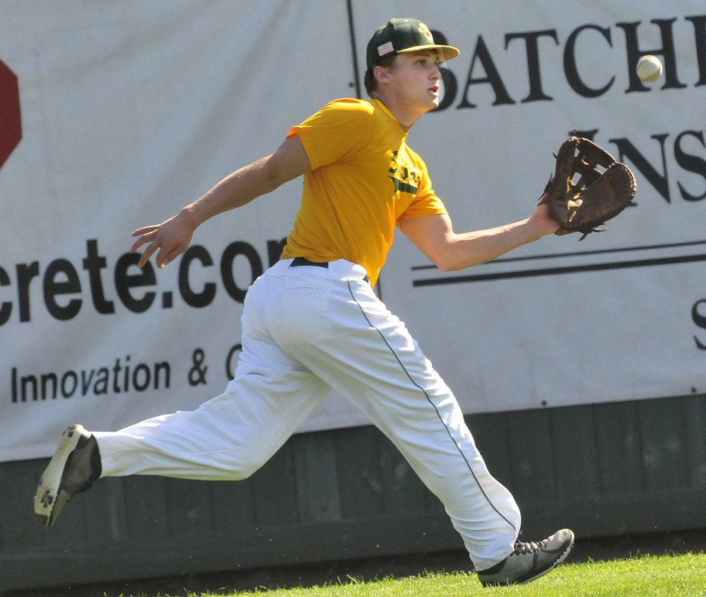 Former Messalonskee star Jake Dexter reaches for a fly ball during practice Wednesday at Goodall Park in Sanford. Dexter plays on the Sanford Mainers in the New England Collegiate League.