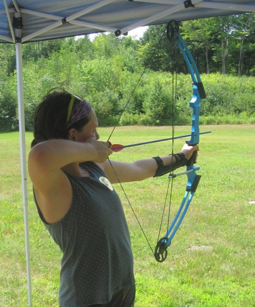 Sarah Richards works on her archery skills at Wilton Fish and Game Association.