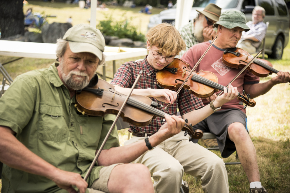 Fiddlers and musicians of all ages and skills play together at the annual East Benton Convention on Sunday. From left are: Barry Crawford, of Monroe, Joshua Rosenthal, 13, of Damariscotta and Charlie Moen, of Readfield.