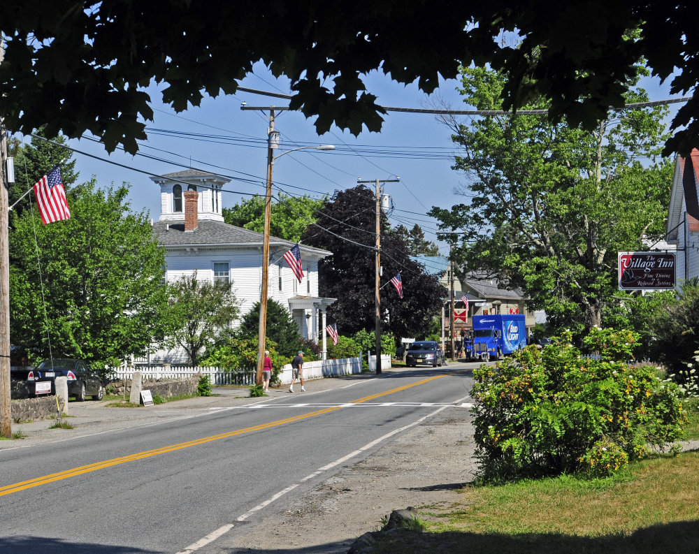 "Route 27 in Belgrade Lakes village is seen in August 2016. Select board members may reconsider a proposed ""Traffic Control and Parking Ordinance"" that mainly would affect the village area."