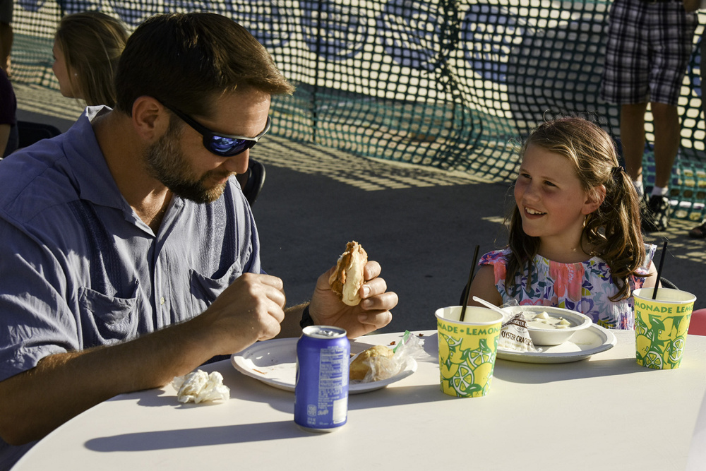 Aaron Podey and his daughter, Elliotte, of Waterville, enjoy their meal Wednesday evening at the 2016 edition of the Taste of Waterville. At the 2017 edition, the beer garden will be set up in Castonguay Square; the Bite, vendors and children's activities will be located in Haines Park in The Concourse, and restauarants will line Main Street with booths.