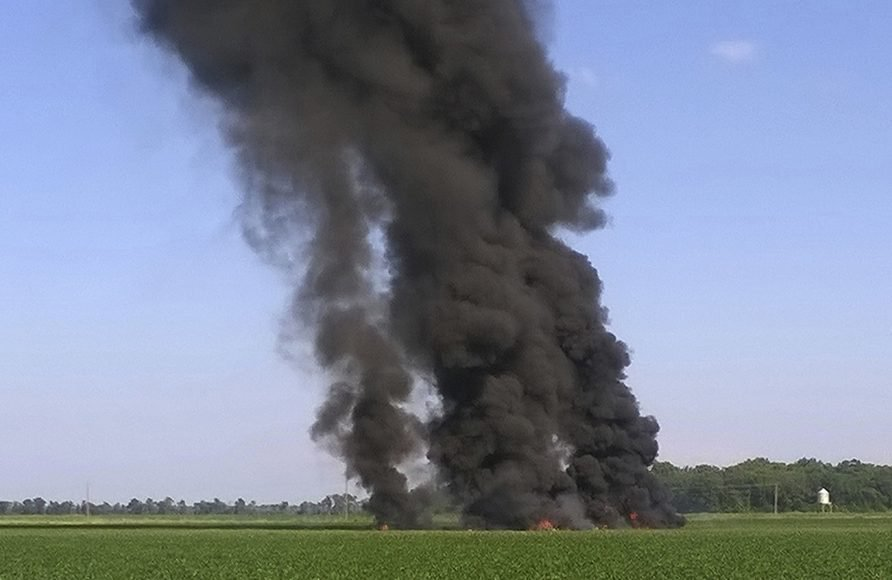 Smoke and flames rise into the air after a KC-130 fuel tanker crashed in a field near Itta Bena, Miss., Monday.