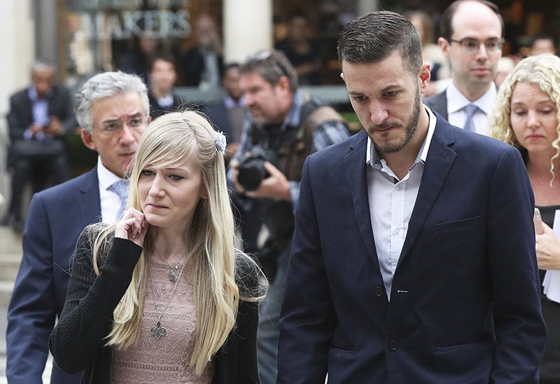 Connie Yates and Chris Gard, the parents of the critically ill infant, arrive at the Royal Courts of Justice in London Monday.