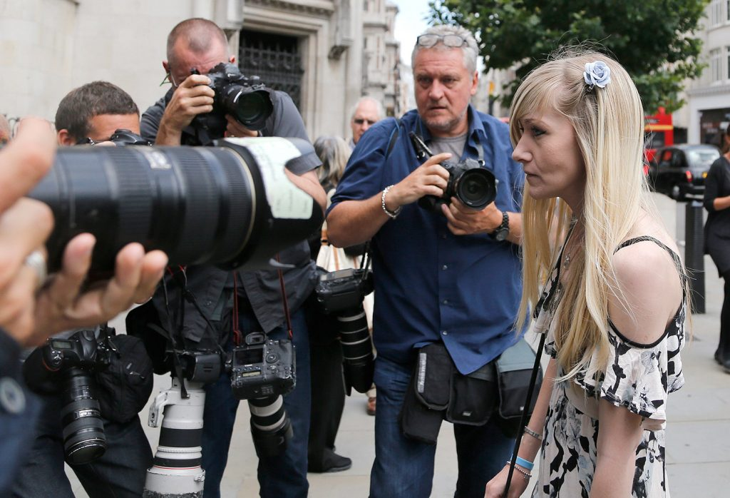 Connie Yates, mother of critically ill baby Charlie Gard arrives at the Royal Court of Justice in London Tuesday. Lawyers for the family of the critically ill infant and the hospital treating him were returning to court for a hearing a day after the baby's parents said they were dropping their long legal battle to get him experimental treatment.