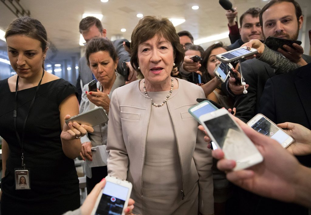 Sen. Susan Collins, R-Maine, is surrounded by reporters as she arrives on Capitol Hill in Washington before a test vote on the Republican health care bill. Collins was caught on a hot microphone Tuesday commenting on President Trump along with Democratic Sen. Jack Reed of Rhode Island.