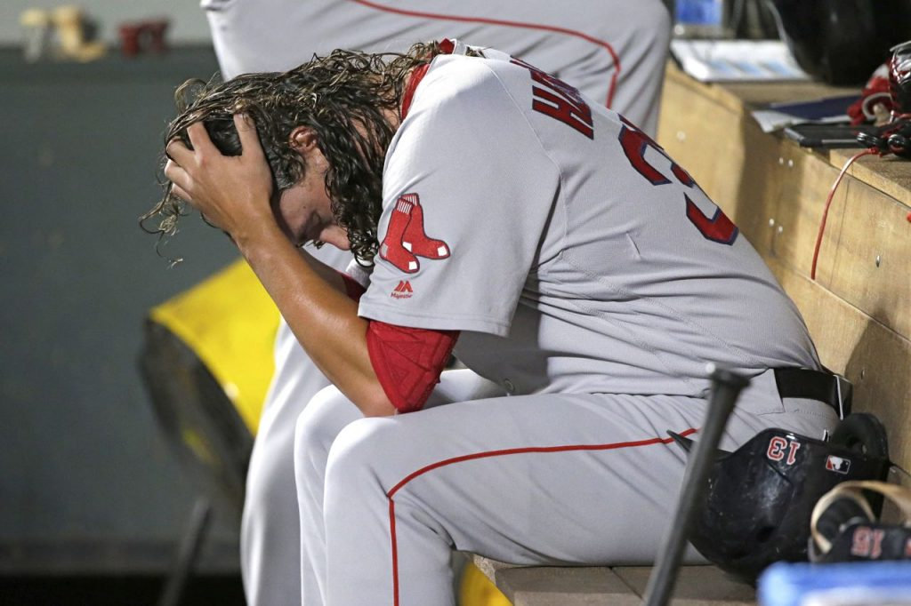 Red Sox pitcher Heath Hembree sits in the dugout after being pulled during the 7th inning of Tuesday night's game against the Seattle Mariners.
