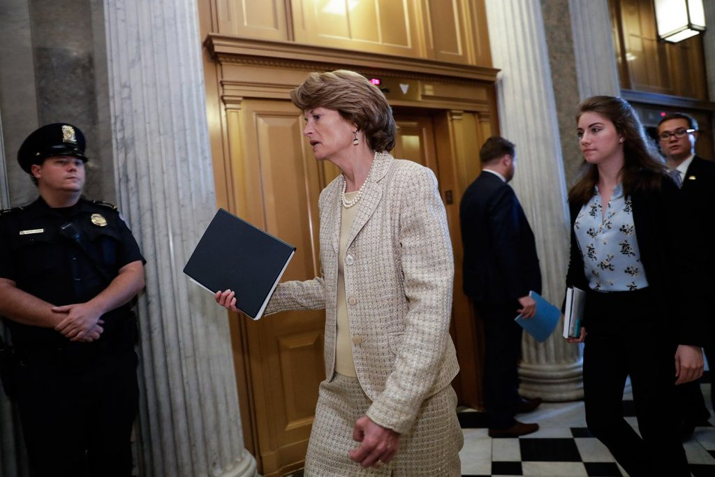 Sen. Lisa Murkowski, R-Alaska, arrives Wednesday for a vote as the Republican-run Senate rejected a Republican proposal to scuttle President Obama's health care law and give Congress two years to devise a replacement.