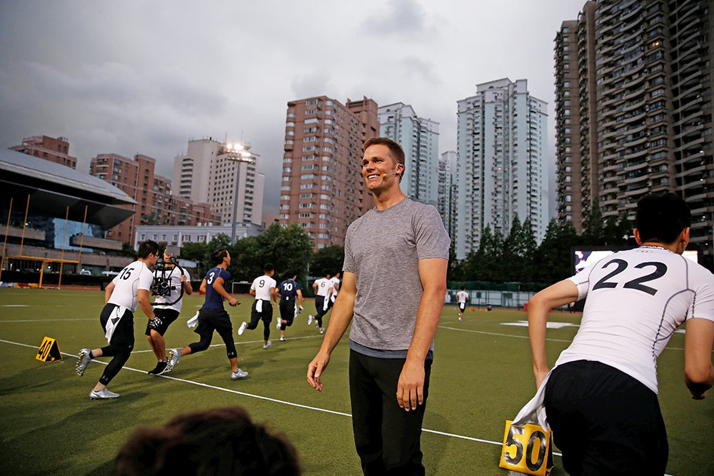 Tom Brady takes part in a promotional training event in Shanghai, China, on June 20, 2017.  Having the greatest quarterback in the sport's history available all season will be a good thing for the Patriots, right? Well, perhaps.