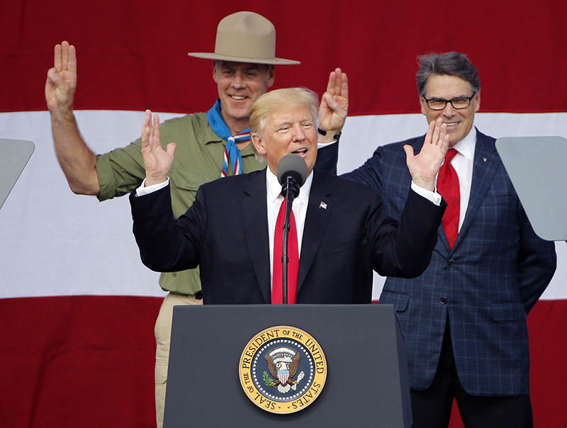 President Trump addresses the 2017 National Boy Scout Jamboree on July 24 while former boys scouts, Interior Secretary Ryan Zinke, left, and Energy Secretary Rick Perry stand behind him.