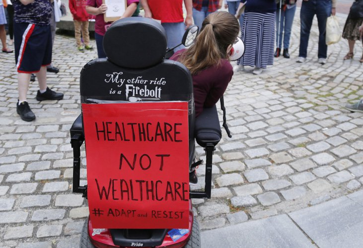 By slashing Medicaid, the Senate ACA overhaul would keep people with disabilities from living independently, says Kingsley Floyd, center. The cuts are a factor in Maine Sen. Susan Collins' opposition to the bill.