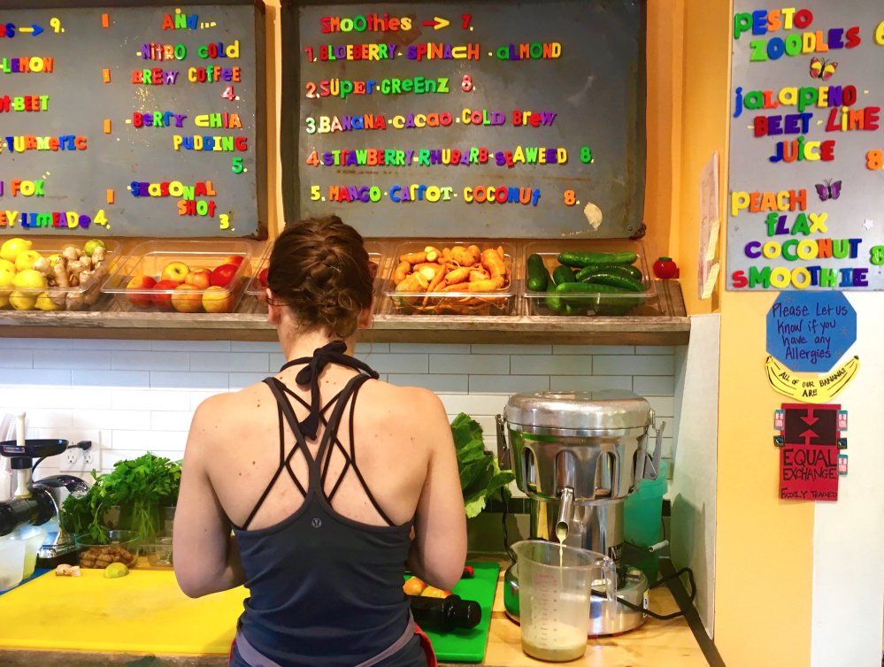 Stephanie Broido makes a kale-lemon juice at Flying Fox Juice Bar in Portland's East End.