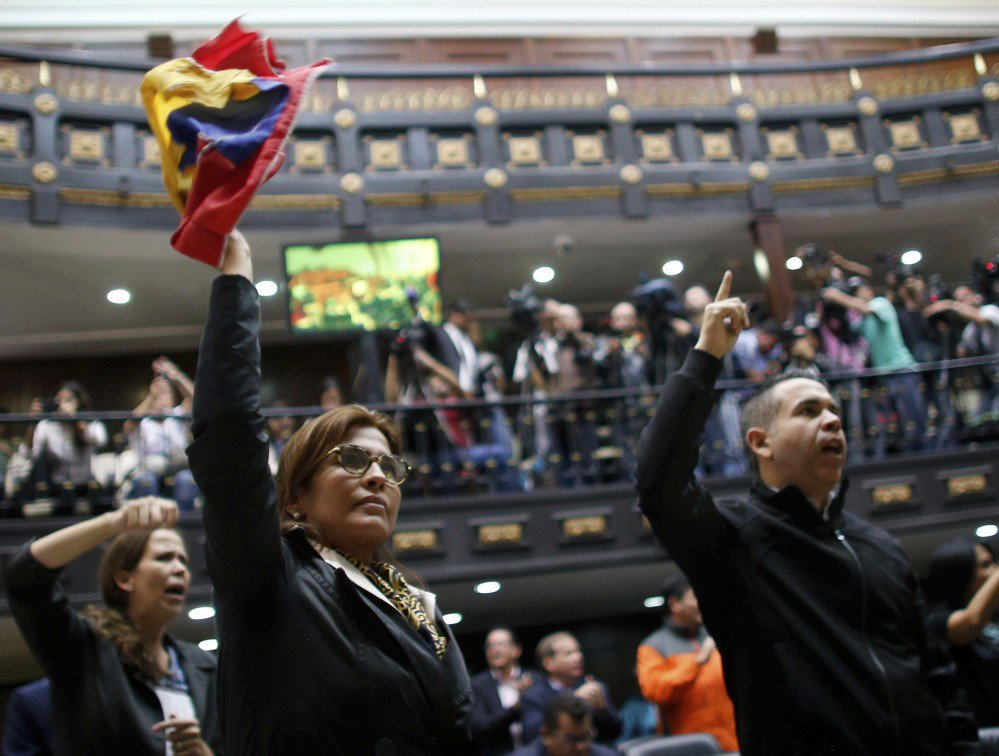 "Anti-government lawmakers shout ""fraud,"" at Venezuela's National Assembly in Caracas on Wednesday. The National assembly and a tech CEO say results were tampered with."