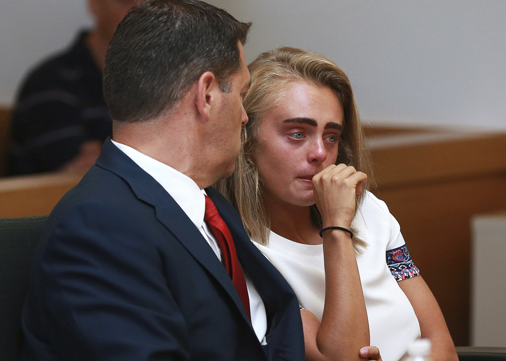 Michelle Carter awaits her sentencing in a courtroom in Taunton, Mass., on Thursday for involuntary manslaughter for encouraging Conrad Roy III to kill himself in July 2014. Carter was sentenced to 15 months in jail for involuntary manslaughter.