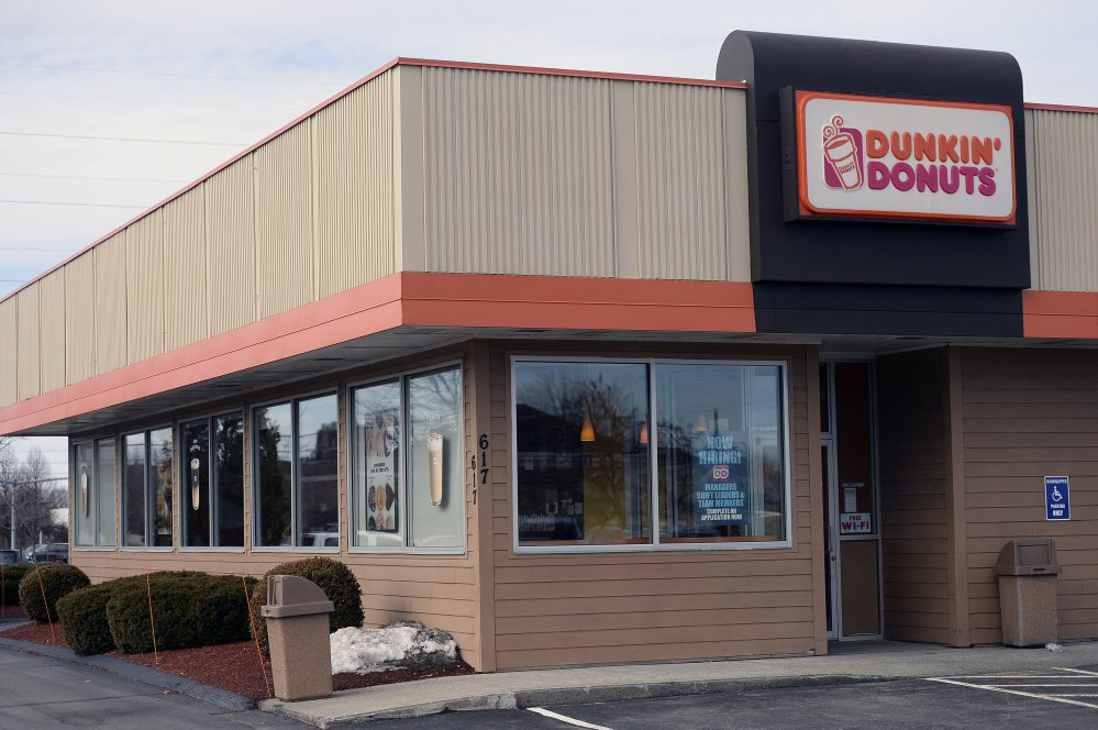 A Dunkin' Donuts is open for business on Broadway in South Portland last winter. In Pasadena, Calif., a new storefront has emerged bearing a new name and slogan: Dunkin'. Coffee and more.
