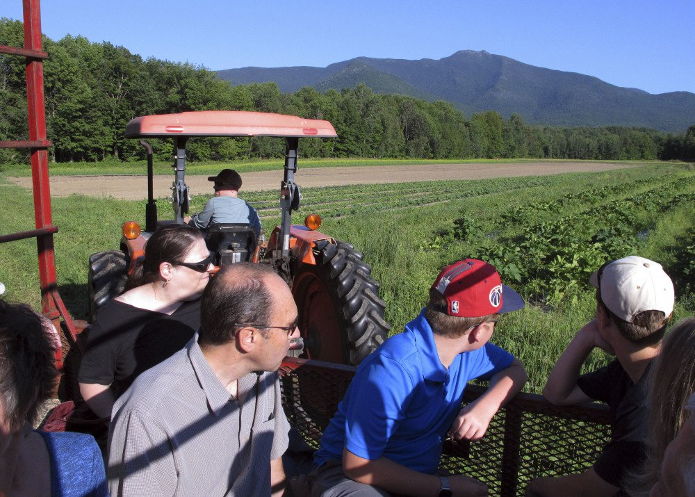 Visitors get a tour of Valley Dream Farm in Cambridge, Vt., before sitting down to eat a weekly dinner featuring produce from the farm and other Vermont-made products.