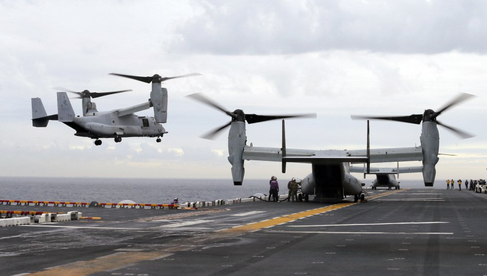 U.S. Marine MV-22B Osprey aircraft land on the deck of the USS Bonhomme Richard amphibious assault ship off the coast from Sydney in June. An MV-22 Osprey that had launched from the USS Bonhomme was conducting regularly scheduled operations when it crashed into the water off Australia's east coast Saturday.
