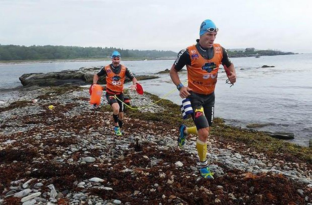 Marcus Barton of Waxhaw, N.C., and Dan Kimball of Fort Mill, S.C., take part in the inaugural Casco Bay Islands SwimRun race last year. This year's event will be held Sunday morning.