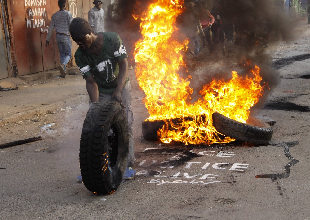 Supporters of Kenyan opposition leader and presidential candidate Raila Odinga demonstrate in the Kibera slum and block roads with burning tires in Nairobi on Wednesday.