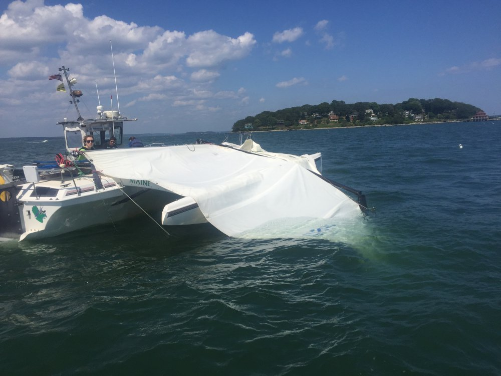 The mast of the Triceratops, a trimaran that berths at South Port Marine in South Portland, snapped Wednesday, severely injuring a woman as she sailed the vessel. The identity of the woman, who was taken to Maine Medical Center, was unavailable late Wednesday.