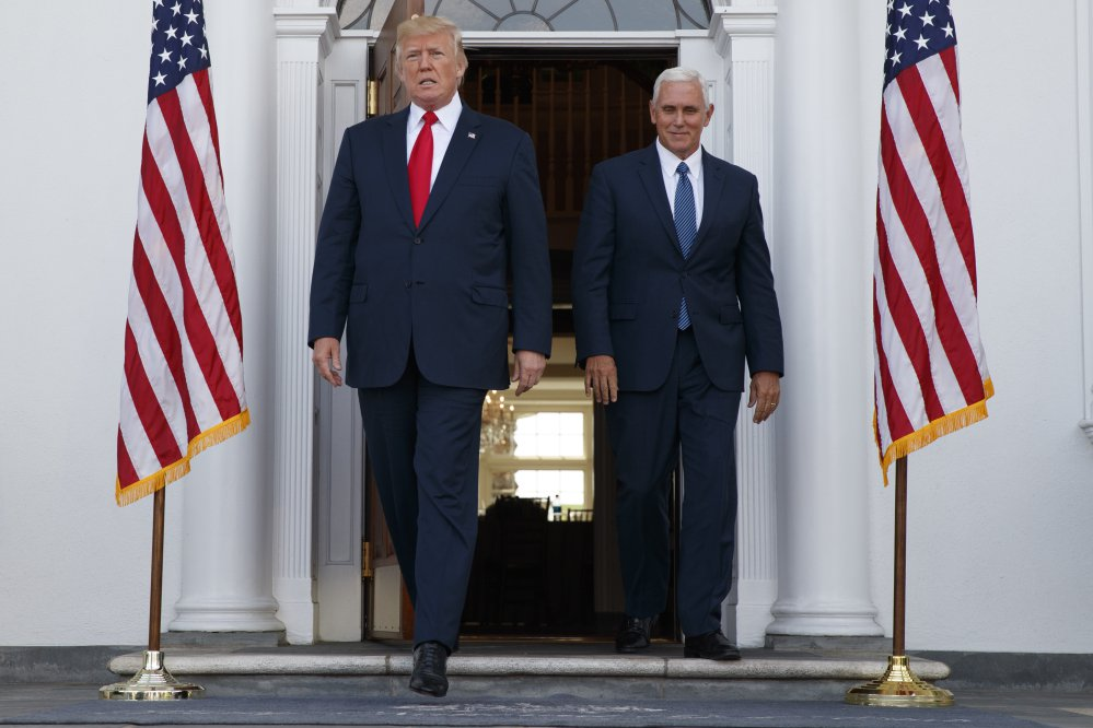 President Trump, accompanied by Vice President Pence, arrives to speak with reporters before a security briefing at Trump National Golf Club in Bedminster, New Jersey on Thursday.