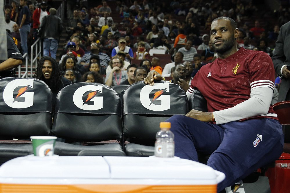 In this Oct. 8, 2015 photo, Cleveland Cavaliers forward LeBron James watches from the bench during a timeout of the second half of a preseason game in Philadelphia.