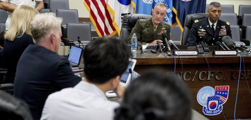 "Joint Chiefs Chairman Gen. Joseph Dunford, center rear, accompanied by United States Forces Korea Commander Gen. Vincent Brooks, right, speaks at a news conference at U.S. Army Garrison Yongsan, Seoul, South Korea, Monday, Aug. 14, 2017.  The top U.S. military officer is warning during a trip to Seoul that the United States is ready to use the ""full range"" of its military capabilities to defend itself and its allies from North Korea. A spokesman says Marine Corps Gen. Dunford also told his South Korean counterparts Monday that the North's missiles and nukes threaten the world. (AP)"