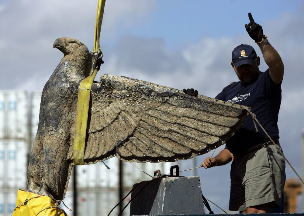 A Uruguayan worker directs the salvage of a Nazi bronze eagle, which has a swastika under its claws, from the German battleship Admiral Graf Spee in Montevideo in 2006.