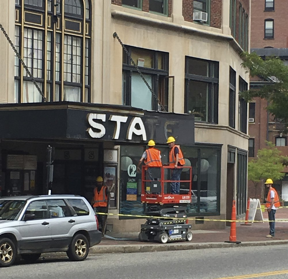 The State Theatre sign is taken down Tuesday. Portland provided a $6,000 facade program grant for the project.
