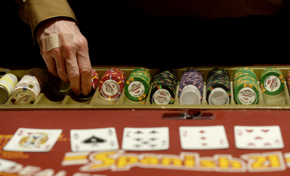 A dealer hands out chips at Oxford Casino in 2013. Maine voters are slated to vote this fall on a referendum to open a York County casino that could be licensed only to Las Vegas developer Shawn Scott; that license is worth an estimated $150 million.