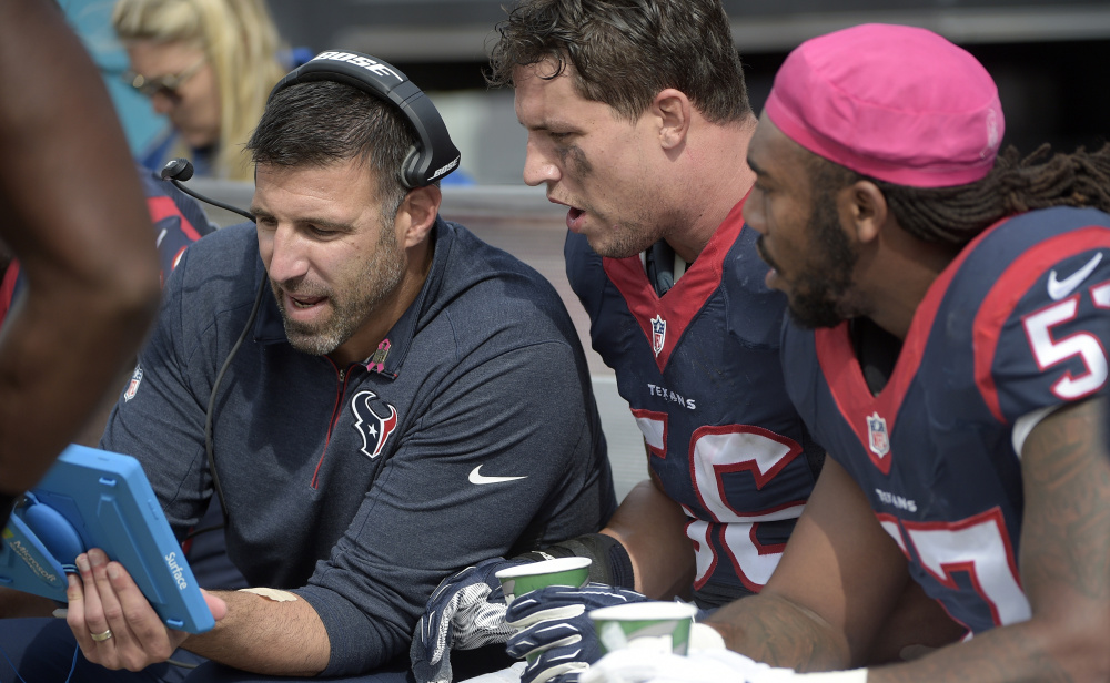 Mike Vrabel, left, once a standout linebacker for New England, spent three seasons coaching Houston linebackers, such as Brian Cushing, center, and Justin Tuggle, and earned himself a promotion to defensive coordinator.
