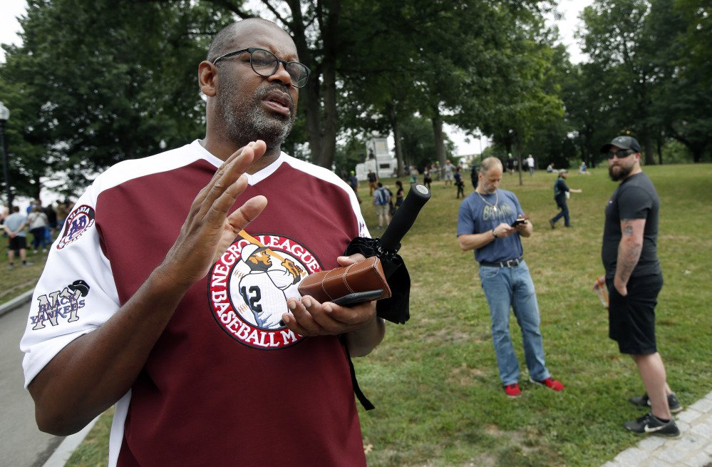 "Former Boston Celtics star Cedric Maxwell stands on Boston Common. Maxwell, a current member of the Celtics radio broadcast crew, planned to participate in the counterprotest to the midday ""free speech"" rally."