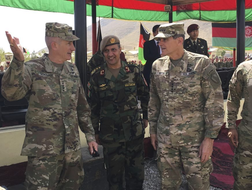 U.S. Gen. John Nicholson, top U.S. commander in Afghanistan, left, talks with Col. Khanullah Shuja, commander of the national mission brigade of the Afghan special operations force, and U.S. Gen. Joseph Votel, head of U.S. Central Command, at Camp Morehead in Afghanistan on Sunday.
