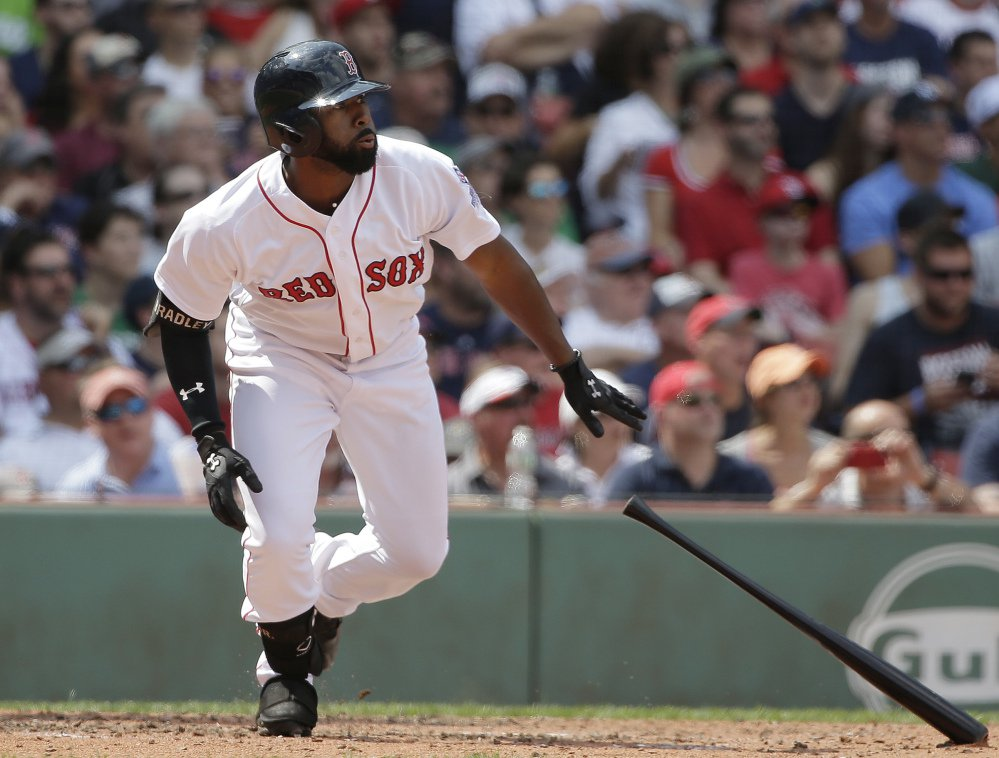 Jackie Bradley Jr. watches the flight of his two-run triple in the second inning of the Red Sox' 5-1 win over the Yankees on Sunday in Boston.
