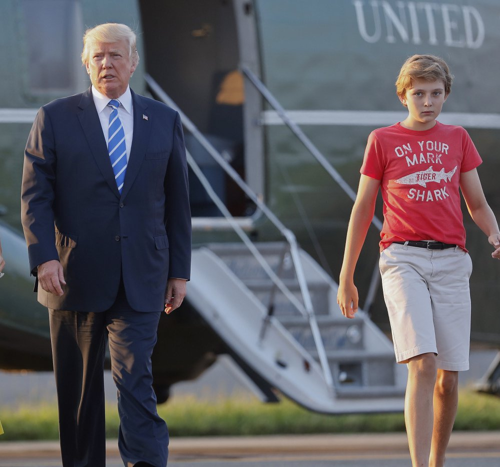 President Trump and son Barron walk across the tarmac to board Air Force One at Morristown Municipal Airport in New Jersey on Sunday for the return flight to the Washington area.