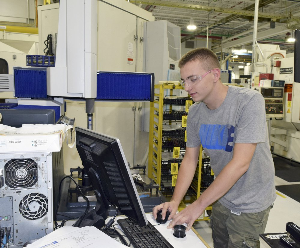 "Tom Teague works at Pratt & Whitney's North Berwick plant after an internship as part of a collaboration with Thornton Academy. ""This is my first job. I'm glad I did it."" he said."