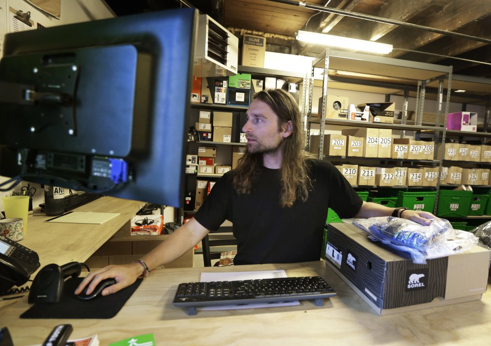 Martin Goldman processes returned items at evo, a Seattle-based sporting goods retailer, which also lets customers pick up orders at competitors' stores.
