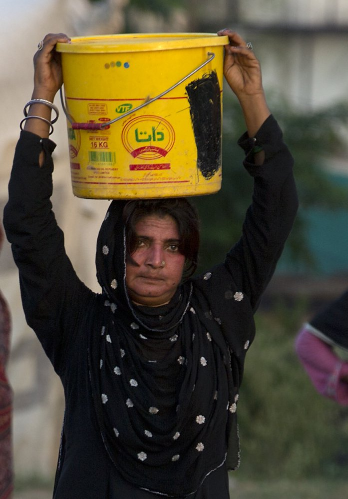 Water that a woman carries from a well in Rawalpindi, Pakistan, could present long-term danger from arsenic, a study suggests.